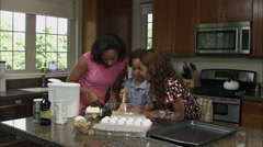 Slow motion of mother, boy, and girl mixing ingredients. Stock Footage