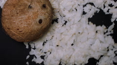 WHOLE COCONUT IS JOINED BY COCONUT FLAKES Stock Footage