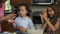 Slow motion of family making balls with cookie dough. Stock Footage