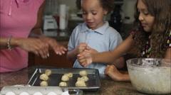 Slow motion of kids smashing cookie dough. Stock Footage