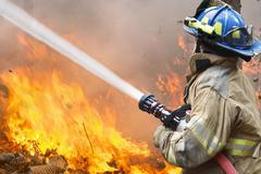 Firefighters battle a wildfire Stock Photos