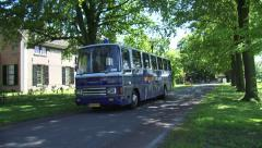 Prisoners bus approaching in historic prison village VEENHUIZEN Stock Footage
