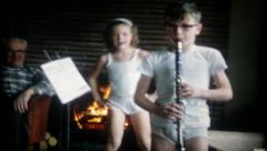 2153 - young boy plays clarinet in his underwear - vintage film home movie - stock footage