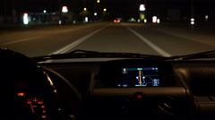 Car driving on highway at night with illuminated dashboard and navigation, PO Stock Footage