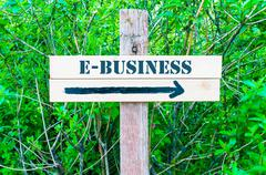 Directional wooden sign with arrow pointing to the right - stock photo