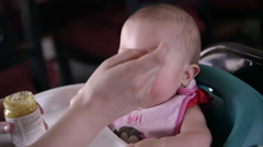 Slow motion view of baby being fed from a spoon. Stock Footage