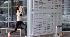 Athletic running fitness woman in urban city - stock footage