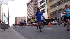 People running on a city road Stock Footage