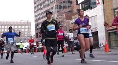 Marathon runners running on Toronto Yonge street Stock Footage