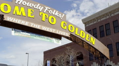 Up close wide pan to the left of the Welcome to Golden Colorado Sign. - stock footage
