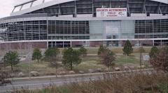 Slow motion upward pan of the Sports Authority stadium. Stock Footage