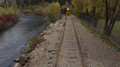 Train Rolling through Scenic Landscape Stock Footage