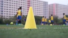 Teenagers playing football in asia, SIngapore - stock footage