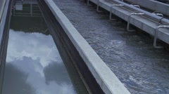 water turbulence in the pool with dirty water treatment plant - stock footage