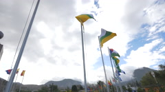 Flags waving at the Middle of the World Monument in Ecuador Stock Footage
