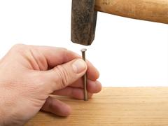 Nail and hammer - stock photo