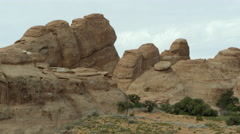 Stock Video Footage of A static shot of the sandstone layers in Arches National Park.