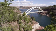 Slow pan from left to right of Cart Creek Bridge at Flaming Gorge in Utah. Stock Footage