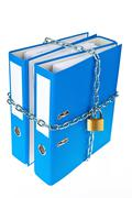 closed file folder with chain - stock photo