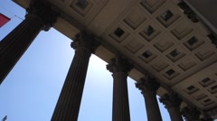Tilt shot of Nelson's Column and the entrance columns of the National Gallery Stock Footage