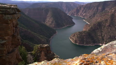 Dolly shot overlooking Flaming Gorge from Red Canyon overlook. Stock Footage