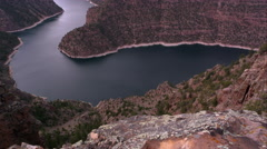 Doward angle dolly shot overlooking Flaming Gorge from Red Canyon overlook. Stock Footage