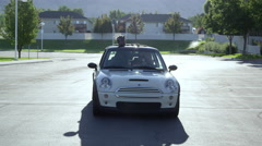 View from the front of a Mini Cooper driving down the road with a Great Dane Stock Footage