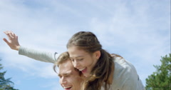 Happy couple enjoying outdoors smiling arms outstretched spinning slow motion Stock Footage