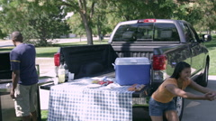 View of family having tailgate picnic. Stock Footage