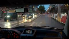 Driving a car at night in urban city traffic Stock Footage