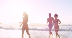 Group of friends swimming in the sea at sunrise multi ethnic diversity - stock footage
