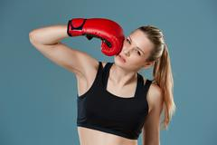 young girl boxer punching herself as self punishment - stock photo