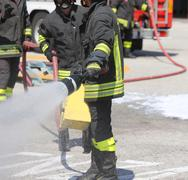 Firefighters with the fire extinguisher during a practice session at Firehous Kuvituskuvat