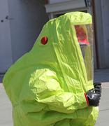person with protective suit to work in presence of asbestos - stock photo