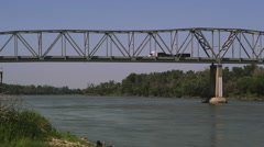 Panning view of bridge over the Missouri River. Stock Footage