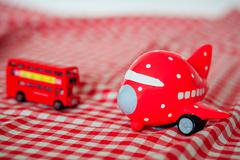 Children's toys, red plane and red double-decker bus Stock Photos