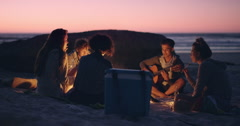 Beach Party at sunset with bonfire and roasting marshmellows with friends - stock footage