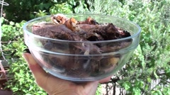Holding a bowlful of cooked wild boar meat 2 Stock Footage