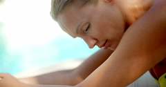 Woman Resting on Fore Arms by Swimming Pool Stock Footage