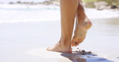Close up of woman feet walking on tropical beach island vacation Stock Footage