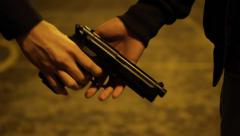 Handing over a gun - stock footage