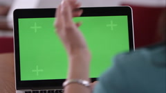 Panning shot of woman using computer with green screen. Stock Footage