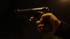 Pistol shooting at night Stock Footage
