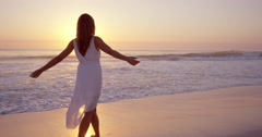 Free happy woman spinning arms outstretched enjoying natural  lifestyle dancing Stock Footage
