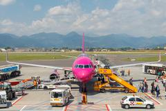 Aircraft Wizz Air aviation company at the airport of Bergamo. - stock photo