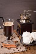 Coffee in glass cup and cinnamon with zephyr Stock Photos