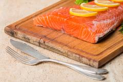 fresh salmon fillet with aromatic herbs, spices - stock photo