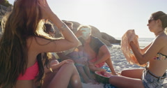 Multi ethnic  Group of friends on the beach hanging out - stock footage