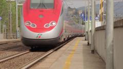 Frecciarossa train passes Rovezzano station Florence Stock Footage