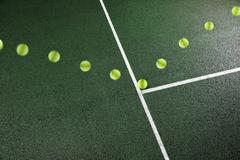 Multiple exposure of tennis ball bouncing on court - stock photo